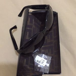 Authentic Fendi sunglasses with matching case.